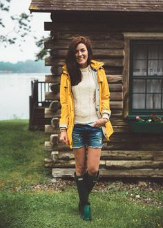 Rainy day style - yellow Barbour rain jacket, cream chunky knit sweater and green Hunter boots