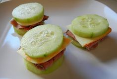 Mini Cucumber Sandwiches.  With a little bit of hummus on these - delish.