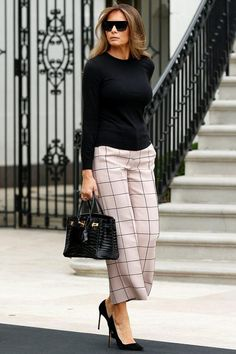 Melania Trump wearing Hermes Crocodile Black Birkin Bag, Valentino Cropped Trousers and Dolce & Gabbana Leopard Sole Pumps