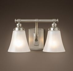 RH's Bistro Double Sconce:With Art Nouveau curves and lozenge finials, Bistro revives the old-world marriage of beauty and utility.