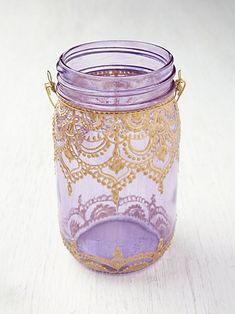 Free People Mason Jar Lanterns  Looks super easy to do yourself, too!  Fabric paint, mason jar, heavy wire.