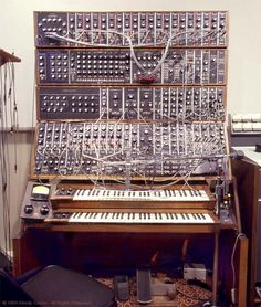 Wendy's Moog Synthesizer in 1979  Top tier, from the left: 907 fixed filter bank with modified output section, acts as spectrum encoder for vocoder; 10 pairs of 912 envelope followers and 902 VCAs for vocoding each of ten channels.   Second-from-top tier: Polyphonic oscillator bank; 960 sequencer; 914 fixed filter bank, acts as spectrum decoder for vocoder; 967 interface