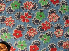 ONE VINTAGE FEEDSACK BLUE WITH SMALL RED GREEN FLOWERS