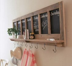 Create a rustic combination of shelf and hook that's very French in style. Use a stripped door or window frame on its side, back it with a board painted in blackboard paint and add a shelf and metal hooks underneath