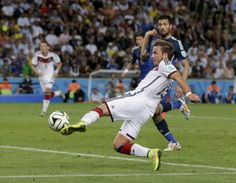 Germany's Mario Goetze kicks to score his side's first goal in extra time during the World Cup final soccer match between Germany and Argentina at the Maracana Stadium in Rio de Janeiro, Brazil, Sunday, July 13, 2014.