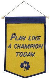 Notre Dame Fighting Irish Play Like A Champion Today Wool Mini Banner by Winning Streak. $24.99. The Dynasty Collection was designed to pay tribute to the teams that have successfully created a dynasty of championships.  This wall banner is made of genuine wool, and features high quality embroidery and applique.  The wool banner has a compelling combination of craftsmanship and quality.  They are 12 inches by 18 inches in size.. Save 50% Off!