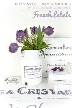 DIY vintage enamel milk jug with distressed and waterproofed French labels.