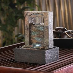 Fountains have long been believed to hold restorative powers to soothe your spirit. This distinctive fountain features the sound of cascading water soft glowing light and striking architectural design
