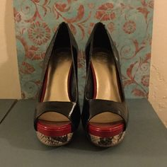 Jessica Simpson heels Snake print trim / black pat. Heels by Jessica Simpson worn two times .... Very good condition Jessica Simpson Shoes Heels
