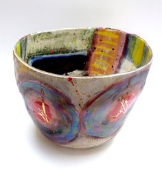 Linda Styles, Wide brimmed vessel with cobalt, yellow ochre and chromium underlay and 3 golden stemmed discs to exterior wall, 26cms x 30cms.