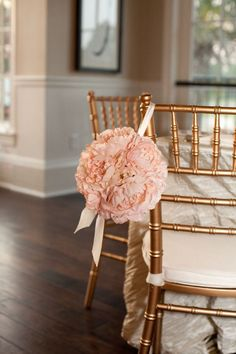 Beautiful gold wedding chairs with pink flower bouquet
