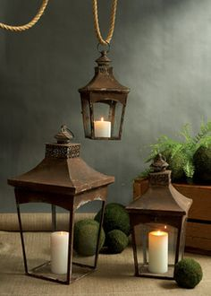 Fill these rustic Pagoda Lanterns with candles and hang at different heights, or display standing on a surface to add texture and dimension to a space. Set of three metal lanterns arrive nested.      Pagoda Hanging Lanterns Set of 3  Back to Home Page