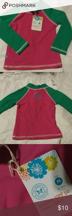 New With Tags UPF 50 swim shirt. Baby Longsleeve The Honest Co. UPF swim shirt with long sleeves Smoke Free Home The Honest Company Swim Rashguards