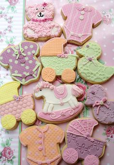 Baby girl..cookies-I bet you could buy fondant and stamps and indent the fondant, then cut to fit the cookie(: