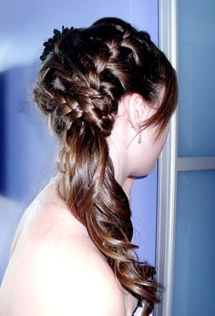 Braided side pony tail by Hair and Beauty BC.