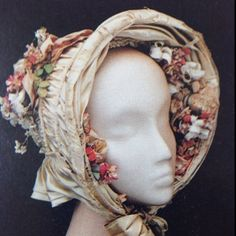 Mid century bonnet. I love the flowers on the inside by beatriz