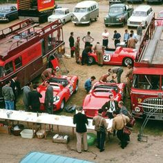 The Scuderia Ferrari pit area at Le Mans in 1963. Besides the 250P racecars (#21 in the background was 1963's overall winner) the both Fiat 642 Bartoletti Scuderia Ferrari works transporters can be seen.