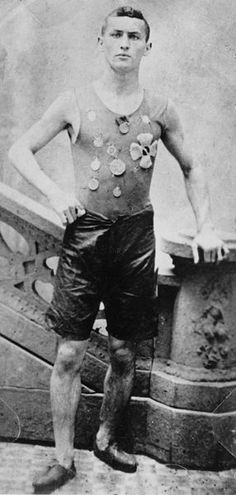 c. 1890. Not yet Houdini, Ehrich Weiss is shown exhibiting his competitive spirit and wearing medals he won as a member of the Pastime Athletic Club track team in New York.