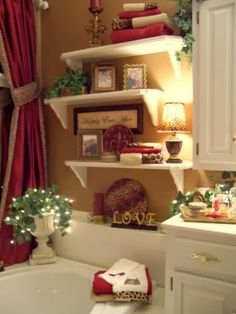 Bathroom decorating ideas. Wow this is so pretty. However, I would be afraid of the stuff falling into the tub.