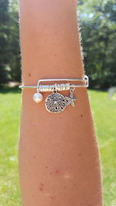 Cute handmade sand dollar starfish charm bangle bracelet with a real pearl charm Handmade by yours truly! Great gift for anyone OR Great gift to treat yourself! Please contact if you have any questions or concerns.