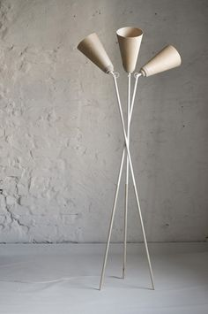 I love this lamp by norwegian she design studio.  Taking a classic lamp and reworking it in such a modern norwegian way.  You guys lurv the wood.