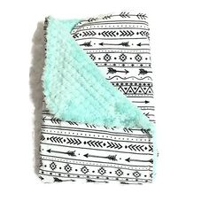 This is an adorable gender neutral baby blanket. It is designed as a chic travel security blanket, carseat blanket.  It is a beautiful black and white arrow print baby blanket with teal minky backing! This amazing blanket is available in several sizes (see our Arrow Blanket Section). It is so cute, unique, and the backing is so soft!  It is washable in cool cycles. Product Details: Front Fabric- 100% cotton Print- White with Black Tribal Arrow. Backing- Teal Dream Cuddle Minkt Size- 20 x 20…