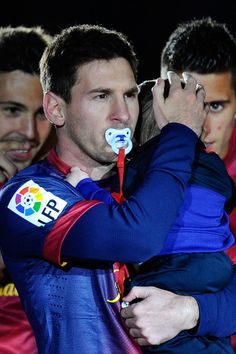 Lionel Messi of FC Barcelona with a dummy holds his son thiago during the celebration after winning the Spanish League after the La Liga match between FC Barcelona and Real Valladolid CF at Camp Nou on May 2013 in Barcelona, Spain. Lionel Messi, Cristiano Vs Messi, Messi And Neymar, Messi Son, Fc Barcelona, Soccer Stars, Football Soccer, Football Memes, Sports Memes