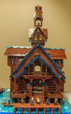 "https://flic.kr/p/sXdepr | Lake-Town | Here are shots of the ArchLUG collaborative build of Lake-Town, as displayed at the Brick and Toy Fair in Ferndale, WA on May 16th, 2015.  Here is the burgomeister's house, by <a href=""/photos/88574960@N02/"" rel=""nofollow"">Bippity Bricks</a>."