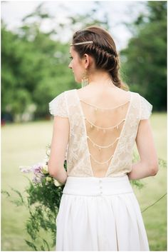 beautiful back detailing on French wedding dress | Image by Elena Joland Photography