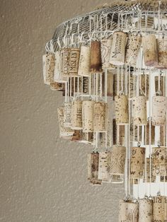 Wine Cork Chandelier made with old fan grate, string, and corks. Maybe add small…