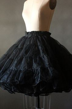 This 50s/60s black triple layer crinoline petticoat is large and lovely! In a rich black and in three sheer layers! Perfect for volume and emphasizing your waist! In excellent condition!  by Malco Modes of San Francisco size M made in USA  waist: 15 to 19 length: 21 3/4