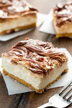 Light + fluffy cheesecake swirled with creamy Nutella sits on top of a graham cracker crust. You will swoon over these No Bake Nutella Swirl Cheesecake Bars No Bake Desserts, Just Desserts, Delicious Desserts, Dessert Recipes, Nutella Cheesecake, Cheesecake Bars, Fluffy Cheesecake, Cream Cheese Recipes, How Sweet Eats