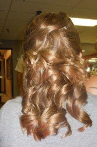 Pinned back, big curls