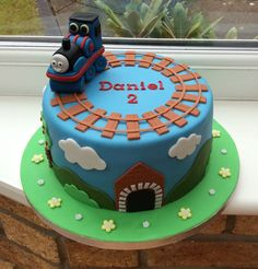 Thomas Cake...instead of a fondant Thomas, I'd just put a toy Thomas train on top