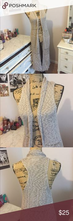 Knit vest A tan knit vest that is 45 inches long. Very pretty and elegant. Perfect for the fall weather 🍁🍂 size small, but would also work for size medium. Altar'd State Jackets & Coats Vests