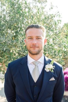 groom in navy suit and silver tie