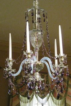 English cut glass chandelier gilded bronze.  Amethyst, blue and clear glass. 1795 – 1810.This chandelier and matching sconces were purchased by Thomas Pearsall,  a New York merchant. They are rare  surviving example of imported English lighting devices. An American Room, the American wing. The Metropolitan Museum of Art, New York City. Original photograph by Christian  Orlov. See matching girandole on this board.
