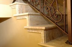 Adding a simple chair rail molding to the edge of this Travertine Staircase by Carved Stone Creations finishes the edges of the treads and risers nicely.  Carved Stone Creations has years of the experience in the design and installation of staircases, from fabricating simple custom stair treads and risers, to grand estate staircases with ornately carved railings.  Click on the image to view a gallery of our staircase projects.