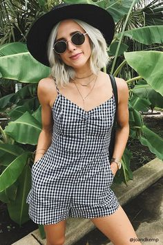 A woven romper by Lush™ featuring an allover gingham print, a V-neckline with a ruched center, adjustable cami straps, back dual self-tie closures, and a concealed back bottom zip closure.