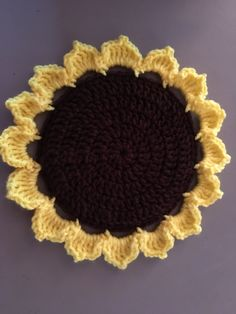 Crocheted Sunflower hot pad by Sandy Johnson February 2017. Size 9""