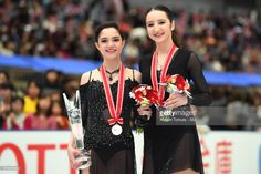 Evgenia Medvedeva of Russia (gold) and Polina Tsurskaya of Russia (bronze) pose with their medals during the ISU Grand Prix of Figure Skating at on November 11, 2017 in Osaka, Japan.
