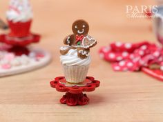 Miniature Food - Please noteh this will be a handmade piece and will show tiny baby differneces:) A beautiful festive Christmas showstopper cupcake presented on its own miniature stand. Decorated with a sitting gingerbread man One of a series of eight. See last photo in