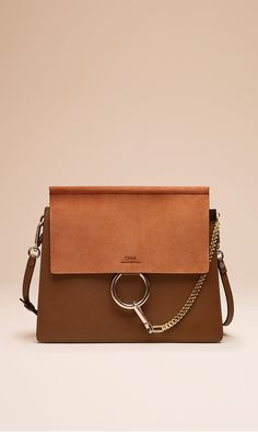 The elegant Faye bag mixes smooth calfskin and rich suede in warm and wintry tobacco tones, for luxe, laid back appeal