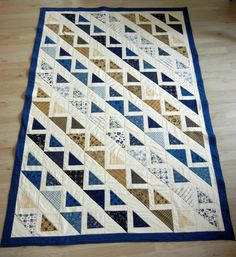 """my project: """"Corn Rows quilt"""" 54x81""""(Pattern by Terry Atkinson for Atkinson Designs from """"Graphic Mixx"""" book) Fabrics are from a Layer Cake of Lexington by Moda, background and border are Moda snow + Admiral blue. (Color choice inspired by this project: https://www.pinterest.com/pin/327003622922915986/ ) Piecing done according to free tutorial by Jenny Doan from the Missouri Star Quilt Company https://youtube.com/watch?v=jnQ1ajB8iK4, 8HST from layer cake, 4HST from 9""""square)"""