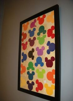 free disney paint samples at Home Depot make a cute display in our Mickey Mouse bathroom :)