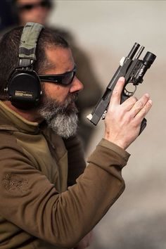 that is tape to cover the sights on his pistol.  teaching reactive shooting when you do not have the luxury of sights