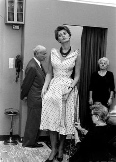 Sophia Loren at a dress fitting in Manhattan, June 1958. Photo by Peter Stackpole.