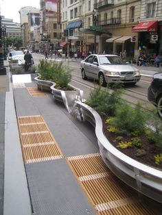 great mix of materials in urban space, San Fran. Best part, hardly any notice of corp rep Audi