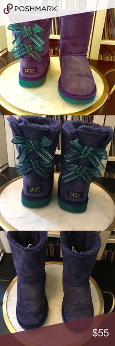 Ugg Bailey Boots in Purple and Teal Authentic Ugh Bailey Bow Booties. Kids size 3 which is equivalent to a women's 5 - 5.5. In very good condition. Slight marks of wear on front of shoe toes as shown in photos, otherwise in very good condition. Beautiful purple and teal colors. UGG Shoes Winter & Rain Boots