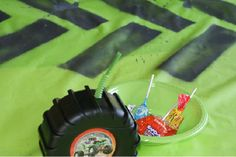 stenciled monster truck tire tracks on tablecloth